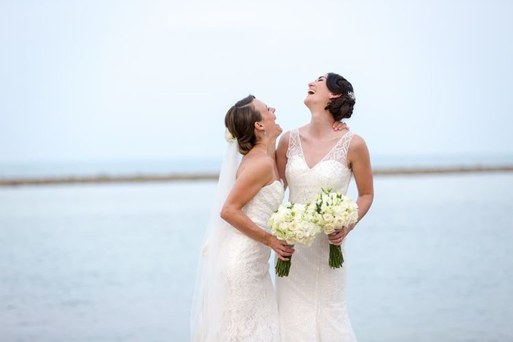 Brides laughing in Mori Lee and Pronovias wedding dresses