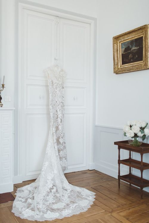Lace Bridal Gown | L'heure Opulente - Laid Back French Chic, Paired with Elegant British Twists by Simply Pergord Weddings at Le Jardin à La Française Chateau | Mathilde Dufraisse Photography