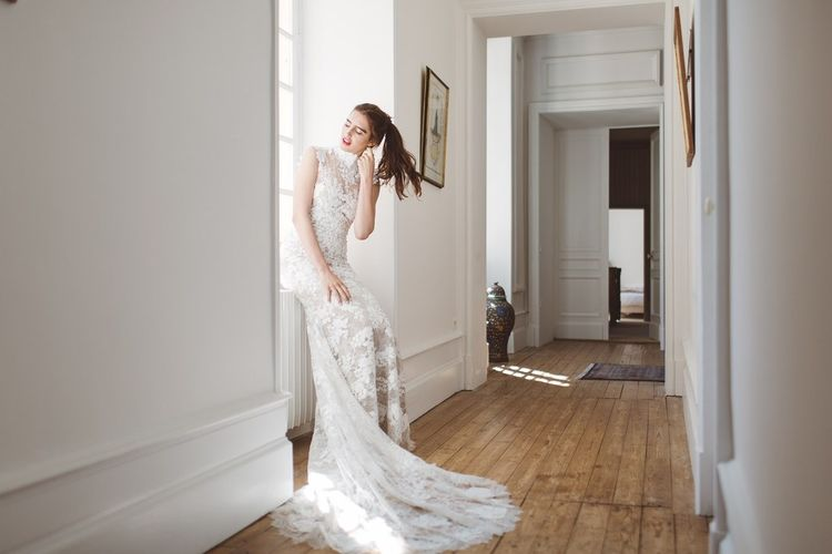 Pronovias Lace Wedding Dress with Puddle Train | L'heure Opulente - Laid Back French Chic, Paired with Elegant British Twists by Simply Pergord Weddings at Le Jardin à La Française Chateau | Mathilde Dufraisse Photography