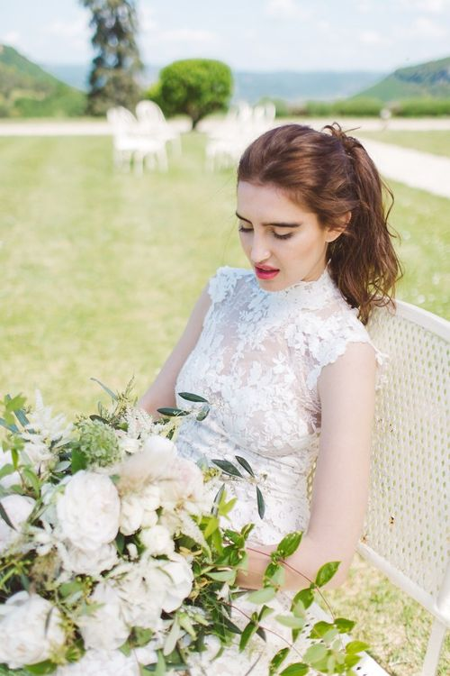 Bride in Pronovias Lace Wedding Dress & White & Green Bouquet | L'heure Opulente - Laid Back French Chic, Paired with Elegant British Twists by Simply Pergord Weddings at Le Jardin à La Française Chateau | Mathilde Dufraisse Photography