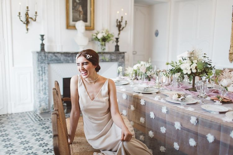 Charlie Brear Bridal Gown | Hermione Harbutt Headdress | L'heure Opulente - Laid Back French Chic, Paired with Elegant British Twists by Simply Pergord Weddings at Le Jardin à La Française Chateau | Mathilde Dufraisse Photography