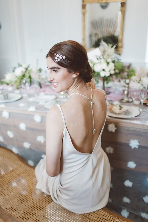 Charlie Brear Backless Bridal Gown | Hermione Harbutt Headdress | L'heure Opulente - Laid Back French Chic, Paired with Elegant British Twists by Simply Pergord Weddings at Le Jardin à La Française Chateau | Mathilde Dufraisse Photography