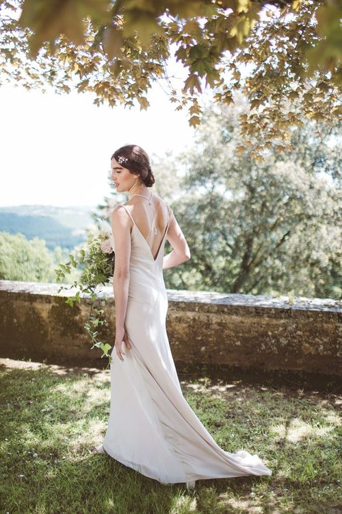 Charlie Brear Backlesss Bridal Gown | Hermione Harbutt Headdress | L'heure Opulente - Laid Back French Chic, Paired with Elegant British Twists by Simply Pergord Weddings at Le Jardin à La Française Chateau | Mathilde Dufraisse Photography