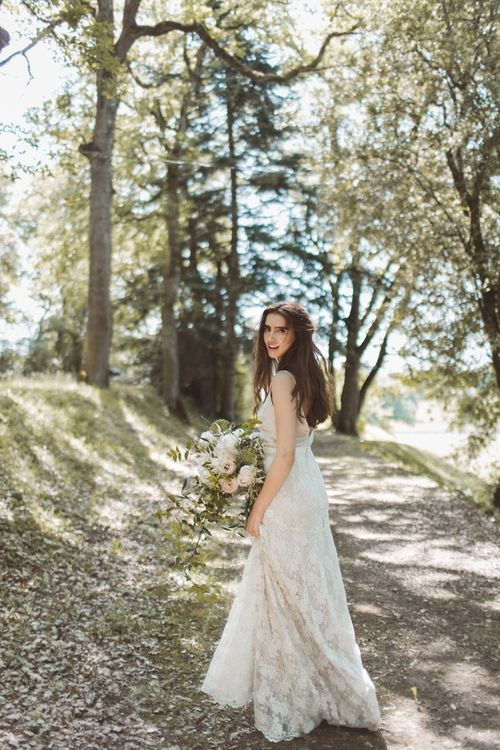 Charlie Brear Bridal Gown | L'heure Opulente - Laid Back French Chic, Paired with Elegant British Twists by Simply Pergord Weddings at Le Jardin à La Française Chateau | Mathilde Dufraisse Photography