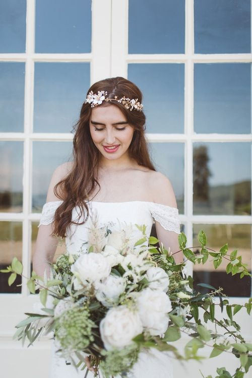 Bride in Bardot Off The Shoulder Wedding Dress & Hermione Harbutt Headdress | L'heure Opulente - Laid Back French Chic, Paired with Elegant British Twists by Simply Pergord Weddings at Le Jardin à La Française Chateau | Mathilde Dufraisse Photography