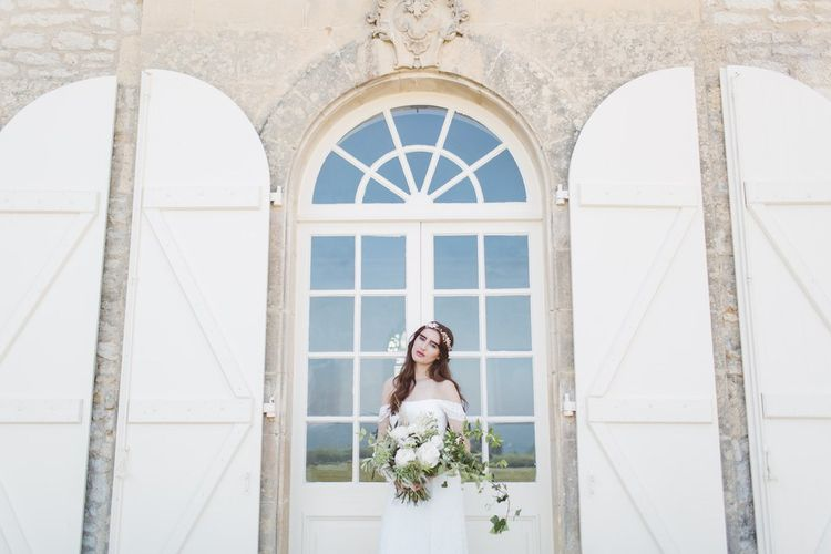 Bride in Bardot off the Shoulder Bridal Gown with Oversized  Bouquet | L'heure Opulente - Laid Back French Chic, Paired with Elegant British Twists by Simply Pergord Weddings at Le Jardin à La Française Chateau | Mathilde Dufraisse Photography