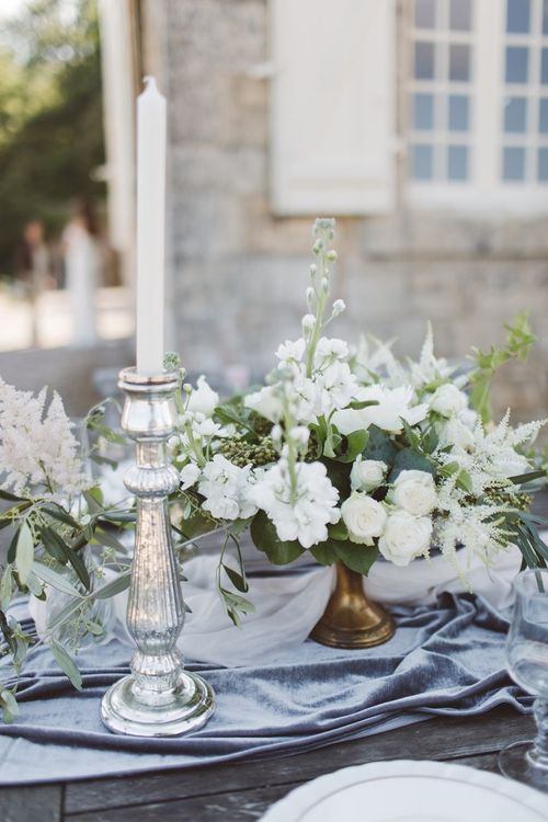 Candle Sticks & Wedding Flower Centrepieces | L'heure Opulente - Laid Back French Chic, Paired with Elegant British Twists by Simply Pergord Weddings at Le Jardin à La Française Chateau | Mathilde Dufraisse Photography