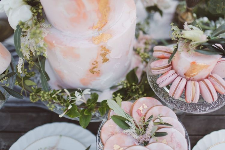 Blush Pink Dessert Table with Cakes & Biscuits by The Little Button Bakery | L'heure Opulente - Laid Back French Chic, Paired with Elegant British Twists by Simply Pergord Weddings at Le Jardin à La Française Chateau | Mathilde Dufraisse Photography