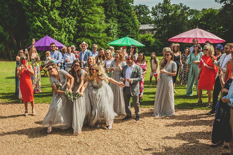 Bouquet Toss | Bridesmaids in Sequin & Tulle Maya Dresses | Pennard House Outdoor Country Garden Wedding | Howell Jones Photography