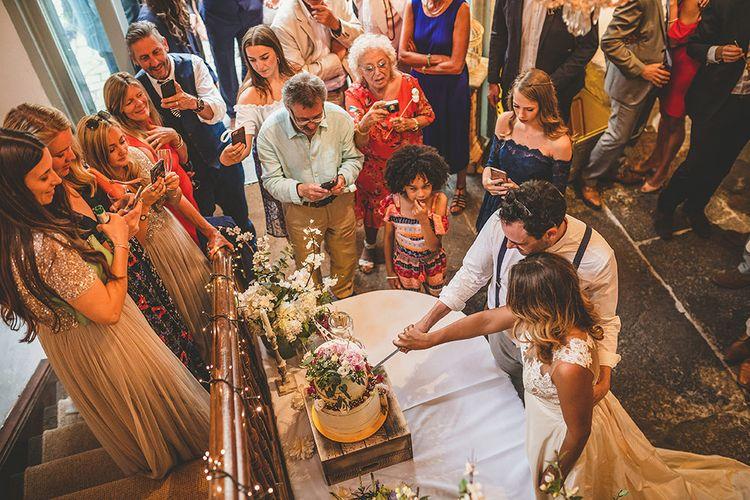 Bride & Groom Cutting the Cake | Pennard House Outdoor Country Garden Wedding | Howell Jones Photography