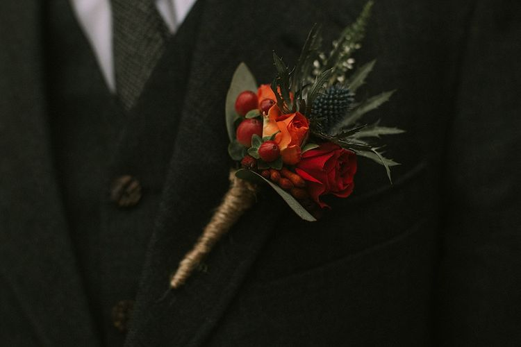 Deep Red & Orange Buttonhole | Autumnal Scottish Woodland Wedding at Fernie Castle | Maureen Du Preez Photography