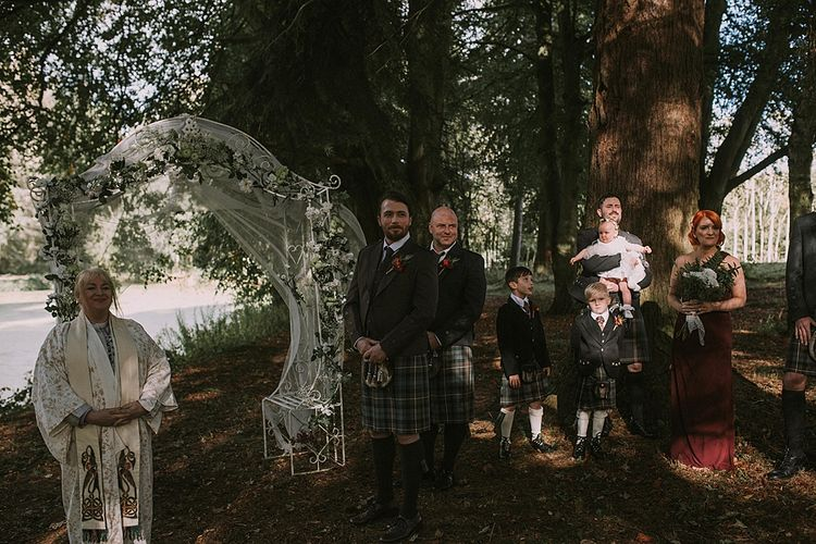 Groom at the Altar in a Tartan Kilt | Autumnal Scottish Woodland Wedding at Fernie Castle | Maureen Du Preez Photography