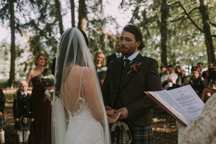 Wedding Ceremony | Bride in Enzoani Gown | Groom in Tartan Kilt | Autumnal Scottish Woodland Wedding at Fernie Castle | Maureen Du Preez Photography