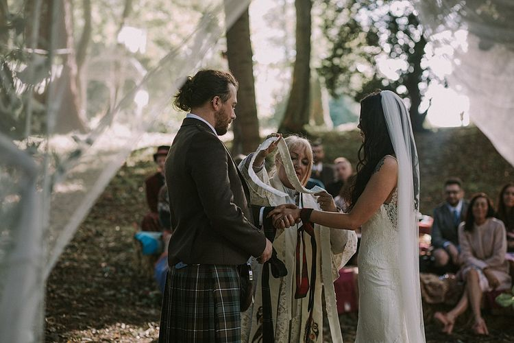 Hand Fastening Wedding Ceremony | Bride in Enzoani Gown | Groom in Tartan Kilt | Autumnal Scottish Woodland Wedding at Fernie Castle | Maureen Du Preez Photography