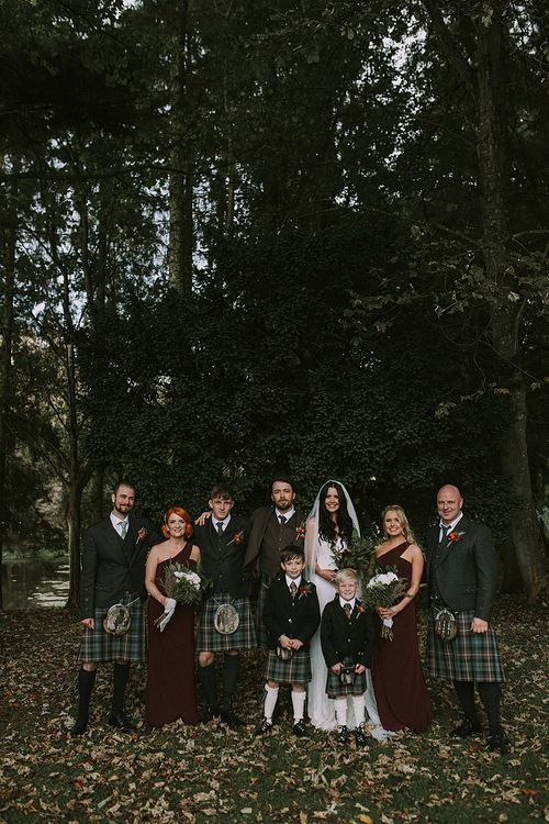 Wedding Party | Bride in Enzoani Gown | Bridesmaids in Burgundy Sorella Vita Dresses | Groomsmen in Tartan Kilts | Autumnal Scottish Woodland Wedding at Fernie Castle | Maureen Du Preez Photography