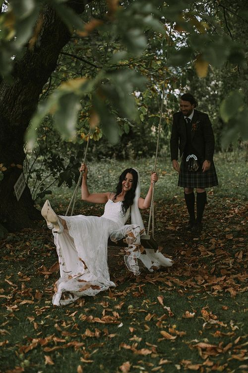 Swing Portrait | Bride in Enzoani Gown | Groom in Tartan Kilt | Autumnal Scottish Woodland Wedding at Fernie Castle | Maureen Du Preez Photography