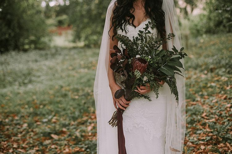 Protea & Greenery Wedding Bouquet | Bride in Enzoani Gown | Autumnal Scottish Woodland Wedding at Fernie Castle | Maureen Du Preez Photography