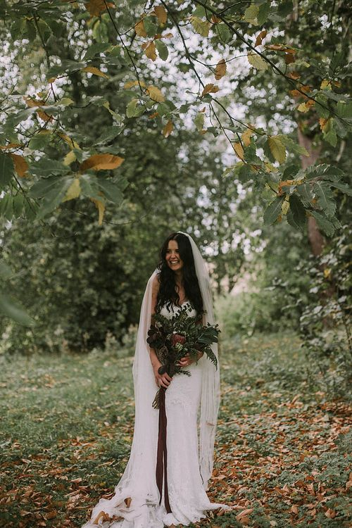 Bride in Enzoani Gown | Protea & Foliage Oversized Bouquet | Autumnal Scottish Woodland Wedding at Fernie Castle | Maureen Du Preez Photography