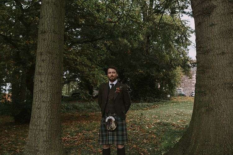Groom in Tartan Kilt | Autumnal Scottish Woodland Wedding at Fernie Castle | Maureen Du Preez Photography