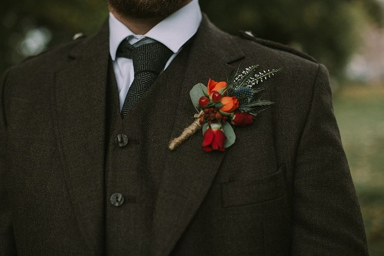 Deep Red & Orange Buttonhole | Groom in Tartan Kilt & Tweed Jacket | Autumnal Scottish Woodland Wedding at Fernie Castle | Maureen Du Preez Photography