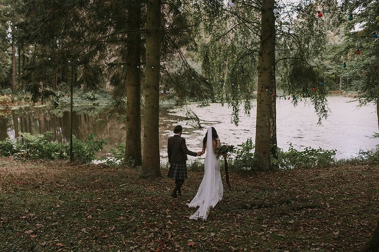 Lakeside Portrait | Bride in Enzoani Gown | Groom in Tartan Kilt | Autumnal Scottish Woodland Wedding at Fernie Castle | Maureen Du Preez Photography