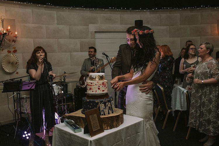 Cutting the Cake | Bride in Enzoani Gown | Groom in Tartan Kilt | Autumnal Scottish Woodland Wedding at Fernie Castle | Maureen Du Preez Photography