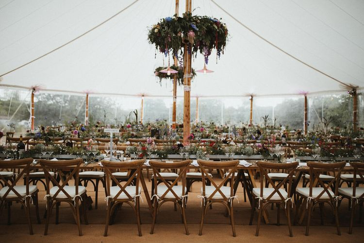 Sailcloth Tent Wedding With Floral Chandeliers // James Frost Photography