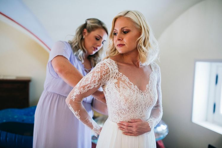 Wedding Morning Preparations | Bride Getting Dressed | Long Sleeved Anna Kara Wedding Dress with Lace Bodice and Soft Skirt | Puglian Countryside Wedding with Fairy Light Altar and Olive Grove Aperitivo | Figtree Wedding Photography