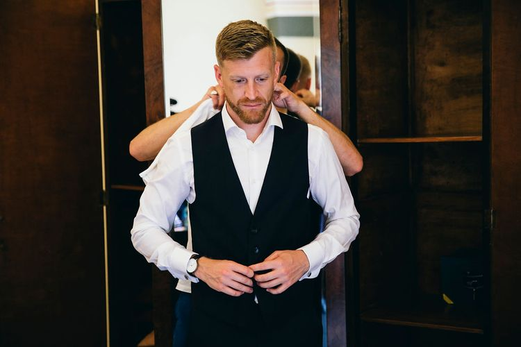 Wedding Morning Preparations | Groom Getting Dressed | Dark Navy Hugo Boss Suit with Waistcoat | Puglian Countryside Wedding with Fairy Light Altar and Olive Grove Aperitivo | Figtree Wedding Photography