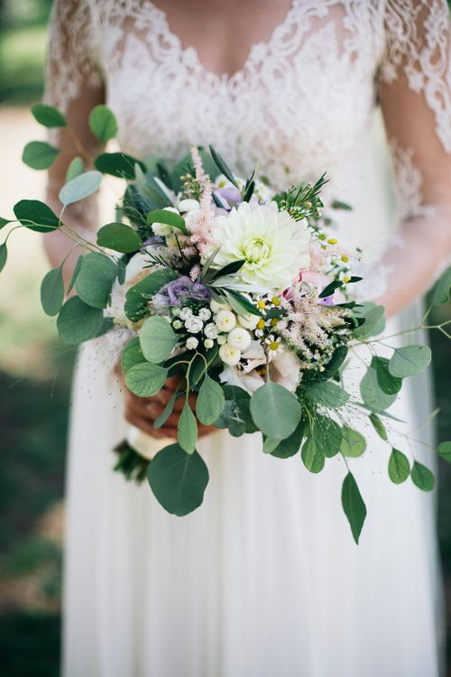 Bridal Bouquet of White, Soft Pink, Purple and Yellow Flowers with Greenery | Bride in Long Sleeved Anna Kara Wedding Dress with Lace Bodice and Soft Skirt |  Britten Weddings Floor Length Veil | Puglian Countryside Wedding with Fairy Light Altar and Olive Grove Aperitivo | Figtree Wedding Photography