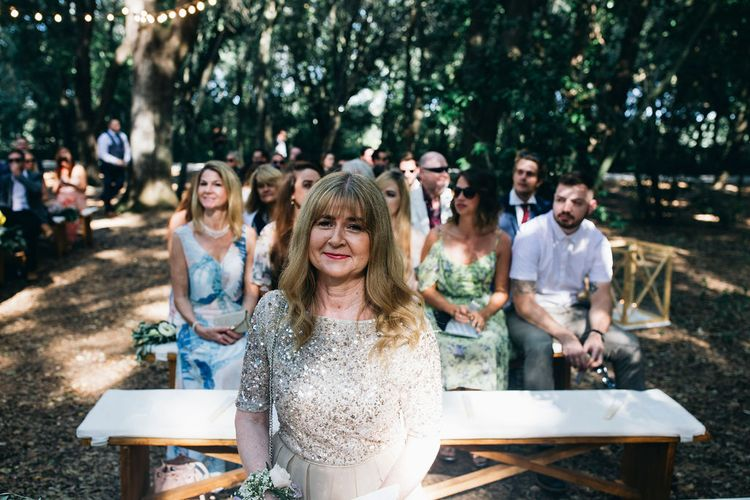 Mother of the Bride in Taupe Adrianna Papell Dress with Sparkly Bodice and Soft Skirt | Puglian Countryside Wedding with Fairy Light Altar and Olive Grove Aperitivo | Figtree Wedding Photography