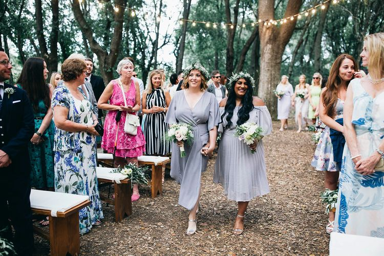 Bridesmaids in Mismatched Lilac Dresses | Bouquets of White, Soft Pink, Purple and Yellow Flowers with Greenery | Flower Crowns | Festoon Lights | Puglian Countryside Wedding with Fairy Light Altar and Olive Grove Aperitivo | Figtree Wedding Photography