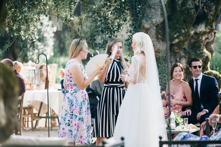 Aperitivo Hour in the Olive Grove at Tenuta Tresca | Bride in Long Sleeved Anna Kara Wedding Dress with Lace Bodice and Soft Skirt | Britten Weddings Floor Length Veil | Puglian Countryside Wedding with Fairy Light Altar and Olive Grove Aperitivo | Figtree Wedding Photography