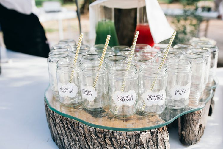 Aperitivo Hour in the Olive Grove at Tenuta Tresca | Mason Jar Drinking Glasses with Gold and White Chevron Straws | Puglian Countryside Wedding with Fairy Light Altar and Olive Grove Aperitivo | Figtree Wedding Photography