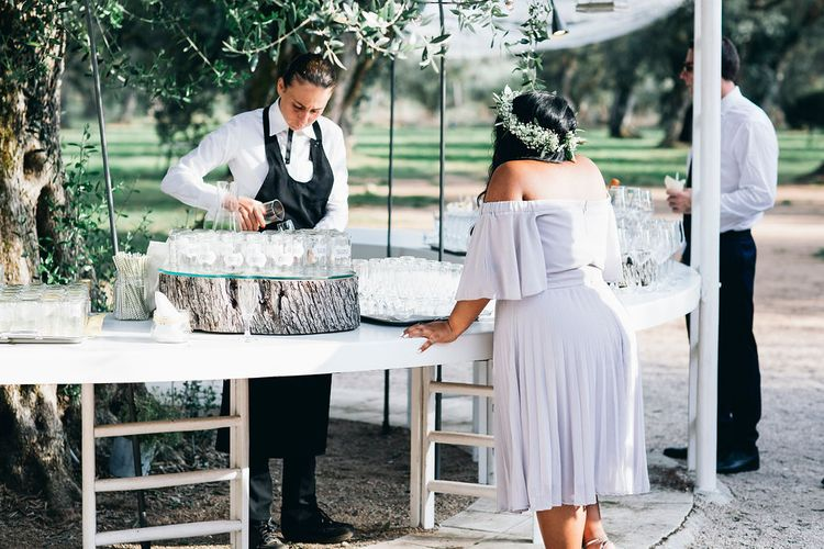 Aperitivo Hour in the Olive Grove at Tenuta Tresca | Mason Jar Drinking Glasses with Gold and White Chevron Straws | Bridesmaid in Lilac Dress | Flower Crown | Puglian Countryside Wedding with Fairy Light Altar and Olive Grove Aperitivo | Figtree Wedding Photography