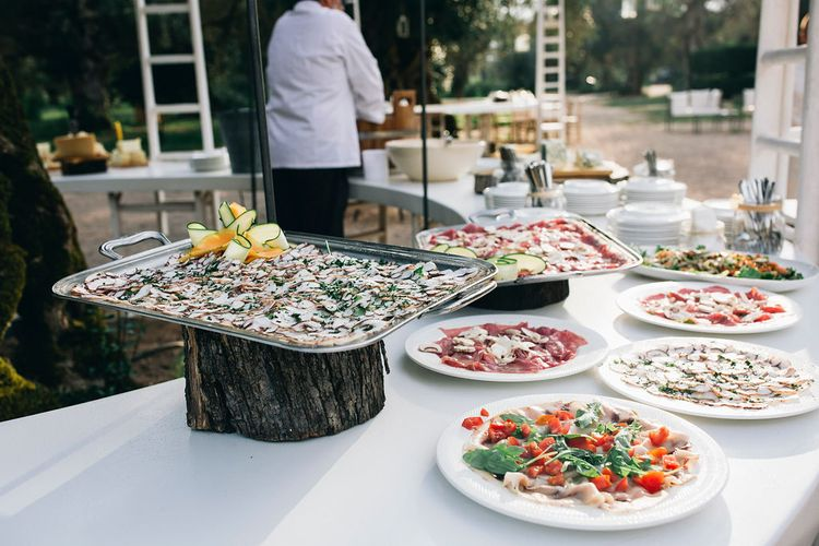 Aperitivo Hour in the Olive Grove at Tenuta Tresca | Traditional Puglian Food | Puglian Countryside Wedding with Fairy Light Altar and Olive Grove Aperitivo | Figtree Wedding Photography