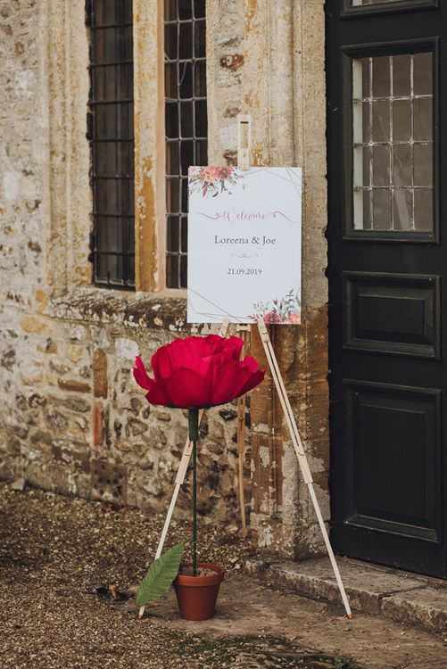 Large flowers at Forde Abbey with welcome sign