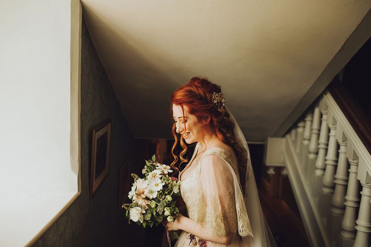Bride in blush wedding dress with braided hair