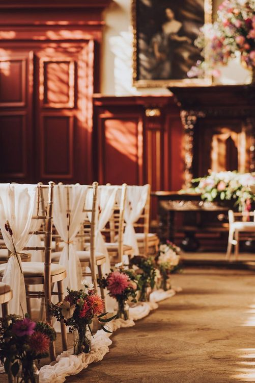 Wedding aisle flowers at Forde Abbey