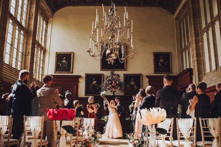 Beautiful wedding ceremony with large flower decor