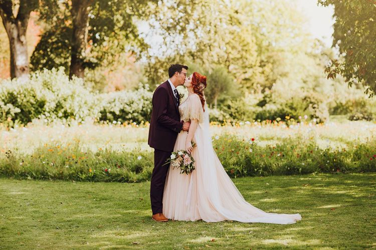 Tulle wedding dress in blush for bride
