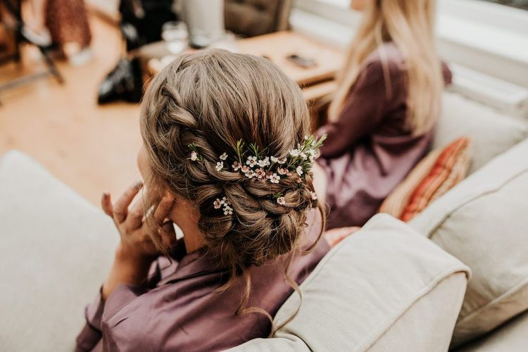 Braided bridesmaid hairstyle with fresh flowers for Priston Mill wedding