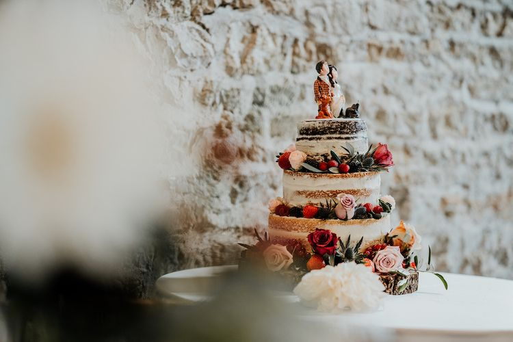 Semi naked wedding cake with bride and groom topper