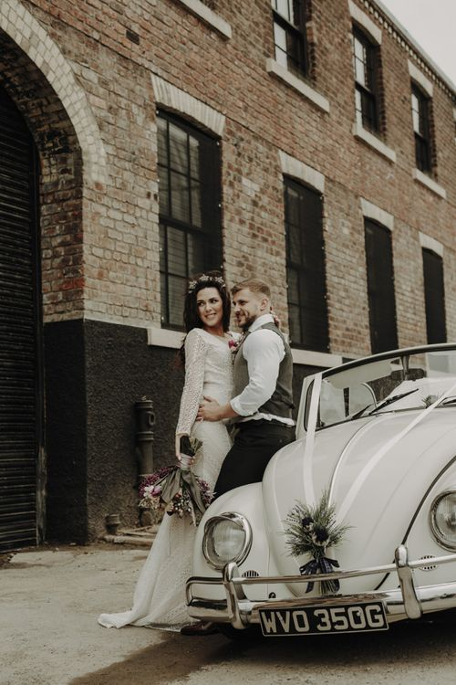 Bride and Groom Standing Next to VW Beetle Wedding Car