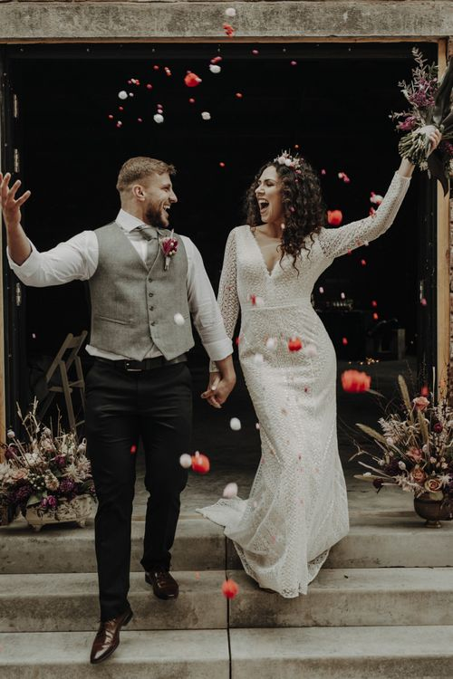 Confetti Moment with Bride in Lace Wedding Dress and Groom in Wool Waistcoat