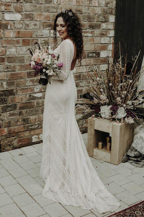 Boho Bride in Lace Wedding Dress Holding Dried Flower Bouquet