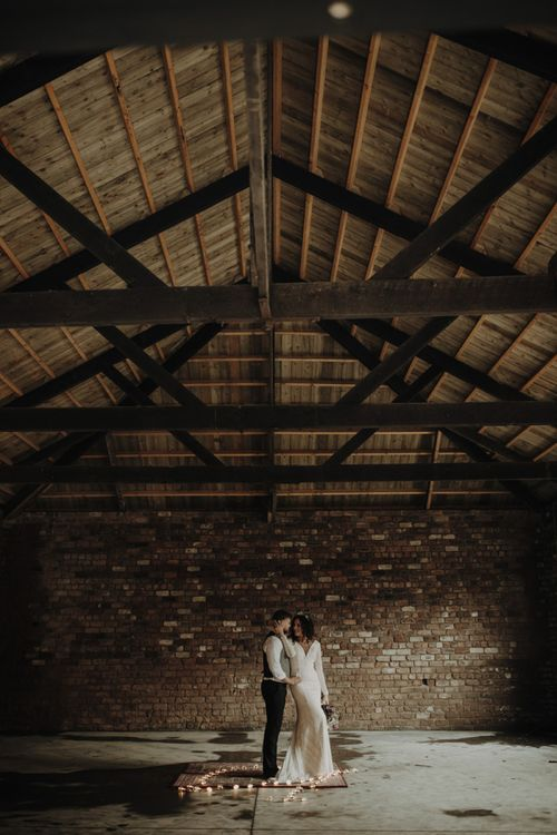 Boho Bride and Groom Standing in The Engine Works Glasgow Wedding Venue