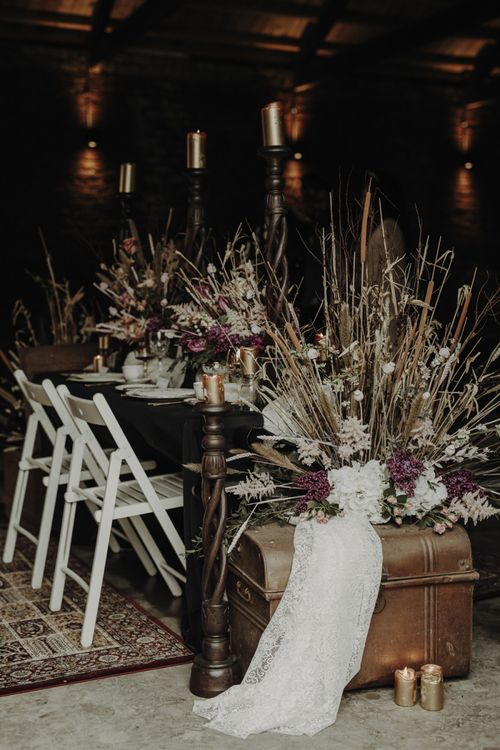 Tablescape with Wooden Chairs, Vintage Trunk and Dried Flower Arrangements