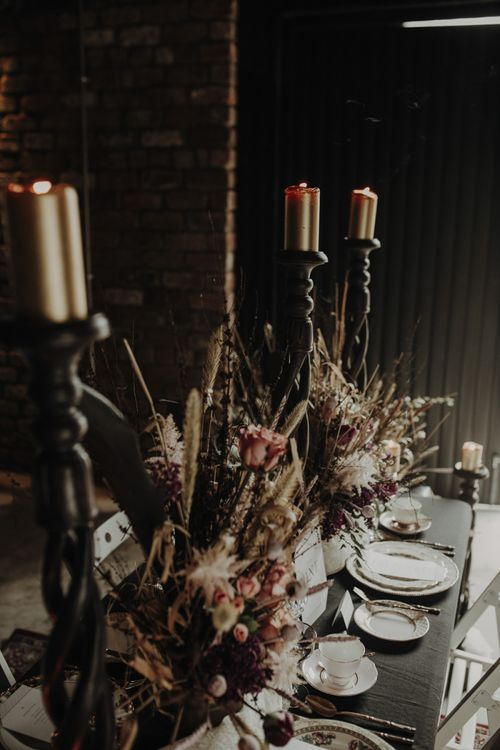 Floral Centrepieces featuring Dried poppy Heads and Grasses