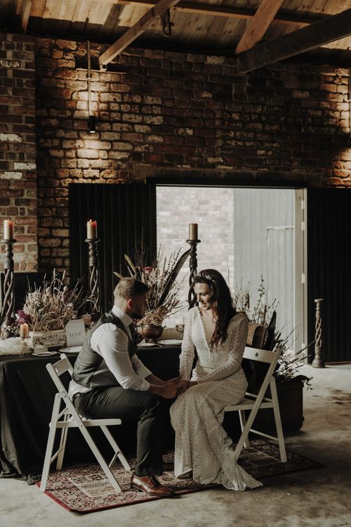 Boho Bride and Groom Sitting at Rustic TableScape in The Engine Works Glasgow